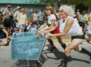 "A female impersonator, known as Gina Maseratti, left, and Gary ""Trampie"" Drews, both of Key West, Fla., compete in the Conch Republic Drag Race in Key West."
