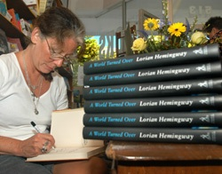 "KEY WEST, Fla. -- Lorian Hemingway, granddaughter of Ernest Hemingway, signs copies of her latest book, ""A World Turned Over,"" at Key West Island Book Store, during the Hemingway Days festival. Lorian Hemingway also announced winners of her 22-"
