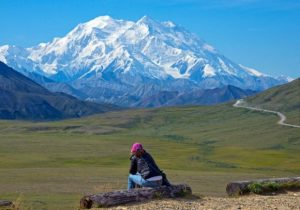 In this Monday, Aug. 3, 2015, photo provided by Holland America Line, a woman gazes at Mount McKinley in Denali National Park and Preserve. On Sunday, Aug. 30, 2015, the White House said that President Barack Obama will change the name of North America's highest peak to Denali restoring an Alaska Native name with deep cultural significance. (Andy Newman/Holland America Line)